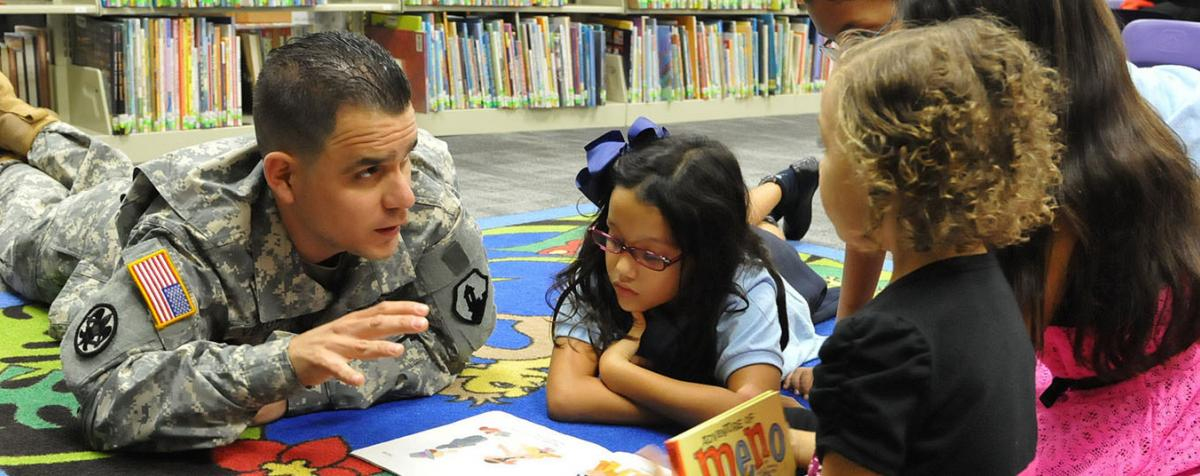 soldier reading to children
