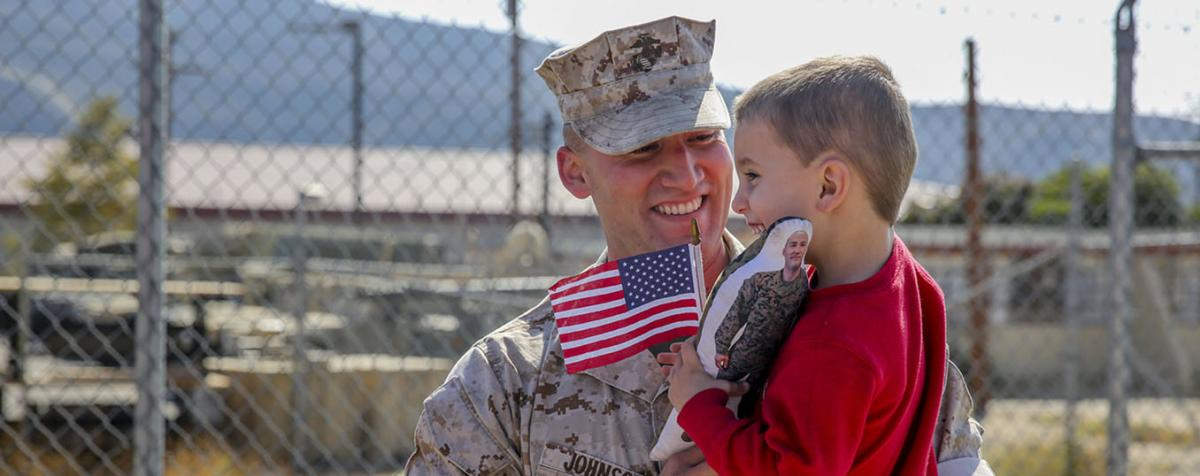 Marine holding child
