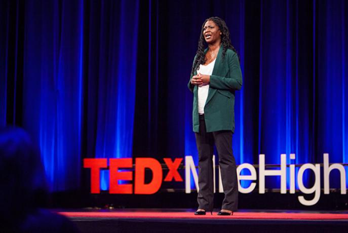 Dr. Apryl Alexander giving a Ted Talk presentation